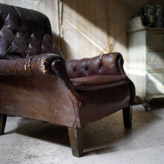 An Early 20thC Leather Upholstered Button-Back Club Armchair c.1915; Kentwell Hall