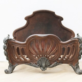 An Antique Rococo Style Iron and Brass Fire Grate