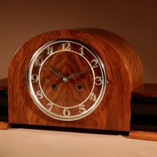 An Art Deco Walnut And Ebonised Mantel Clock circa 1920-40.