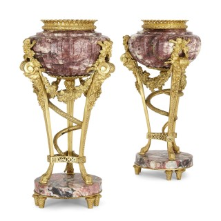 Pair of gilt bronze mounted marble urns after Gouthière