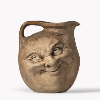 A Martinware double-sided stoneware pottery 'face' jug, dated 1896