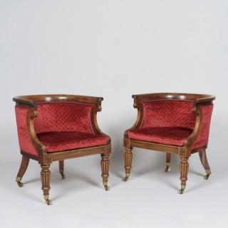 A Pair of Regency Period Bergère Armchairs