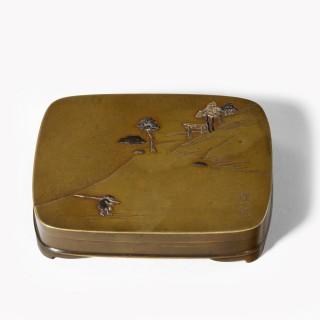 A small Meiji period mixed metal box by Tadakazu