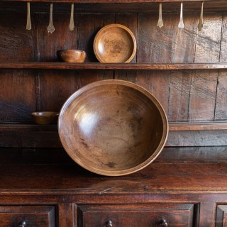 A good George III sycamore dairy bowl, circa 1800
