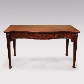 A George III period carved mahogany serpentine serving table