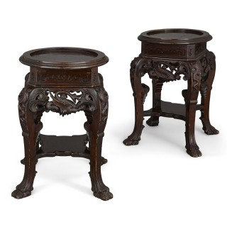 Pair of Chinese stained and carved wood pedestals