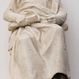 An Antique Plaster Marquette of a Seated Gentleman