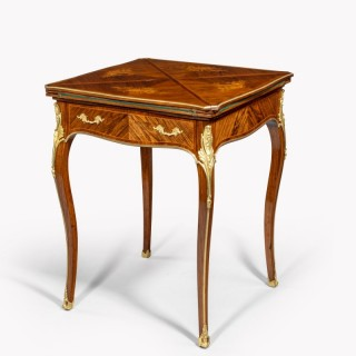 A kingwood marquetry envelope card table