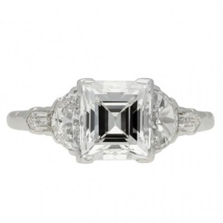 Art Deco square step cut diamond flanked solitaire ring, circa 1930.