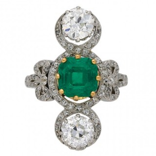 Edwardian Colombian emerald and diamond crossover ring, circa 1915.