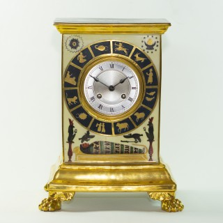 French Empire porcelain clock with Egyptian decoration