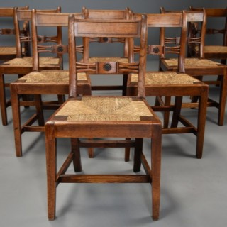 Charming set of eight early 19thc elm country chairs of good patina, probably East Anglian