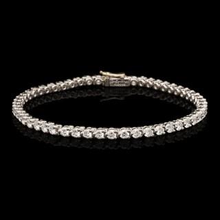 Cartier Classic Round Brilliant Diamond And Platinum Line Bracelet Circa 1960's