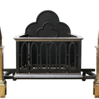 An Antique Gothic Style Fire Grate