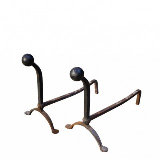 A Pair of Antique Wrought Iron Fire Dogs