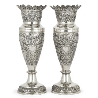 Pair of floral silver vases produced in Qajar Persia