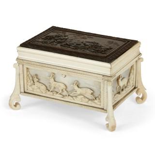 Antique ivory box with bas relief bronze plaque