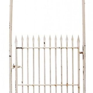 An Antique Wrought Iron Garden Gate with Arched Frame