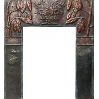 An Arts and Crafts Style Reclaimed Copper Fireplace Insert