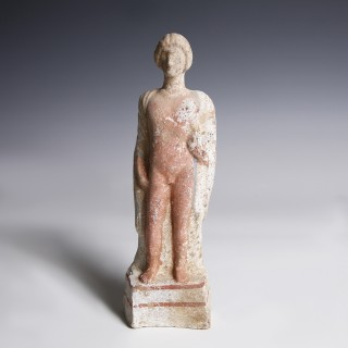 A Greek Terracotta Statuette of a Young Man