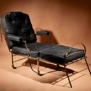 An Original Campaign Wrought Iron and Brass Folding Arm Chair.
