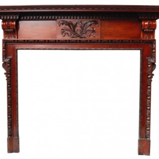 An Antique Neoclassical Style Carved Wooden Fireplace