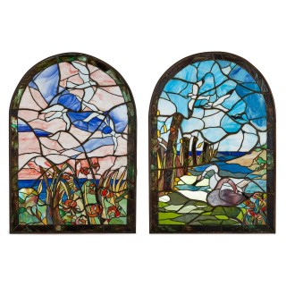 Pair of American stained-glass windows in the manner of Tiffany