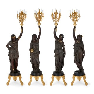 Set of four large Academic style torchères emblematic of the continents