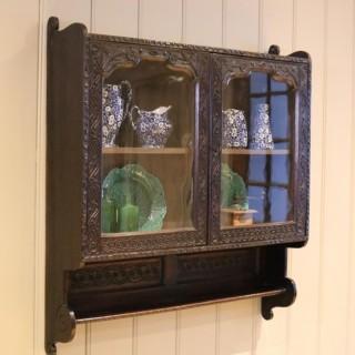 Carved Dark Oak Wall Cabinet