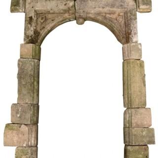 A Reclaimed Georgian Arched Limestone Door way