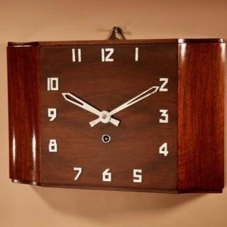 A Stylish Walnut Art Deco Wall / Mantel Clock.