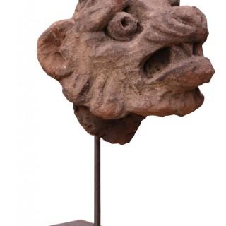 An Antique Carved Stone Lion Head Sculpture