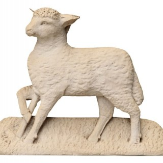 An Antique Plaster Plaque Depicting the Lamb of St. John on a Naturalistic base