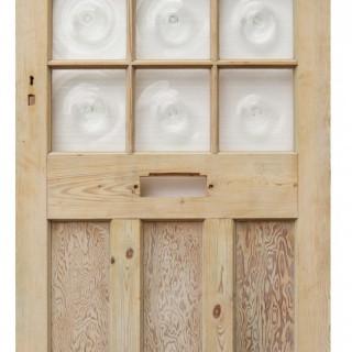 A Reclaimed Bullseye Glass Front Door