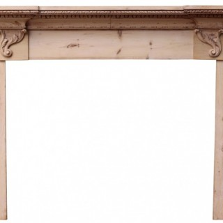 A Reclaimed Antique Carved Pine Fire Surround